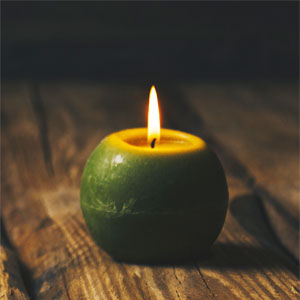 Green Candle Burning
