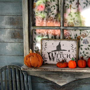 """""""The Witch is In"""" Sign on Window Ledge"""